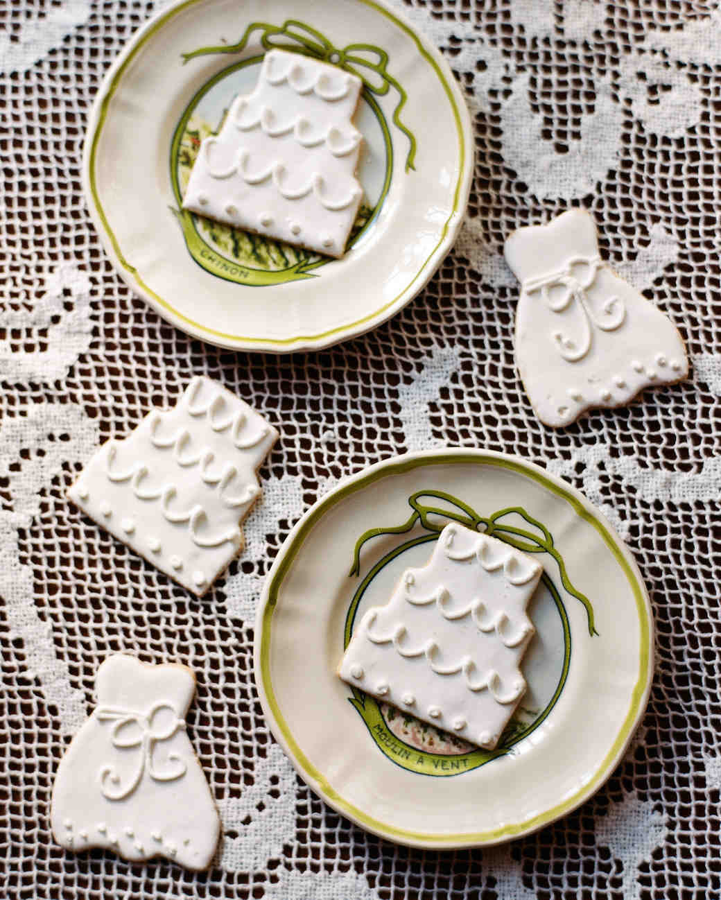 wedding cookies on lace tablecloth green plates