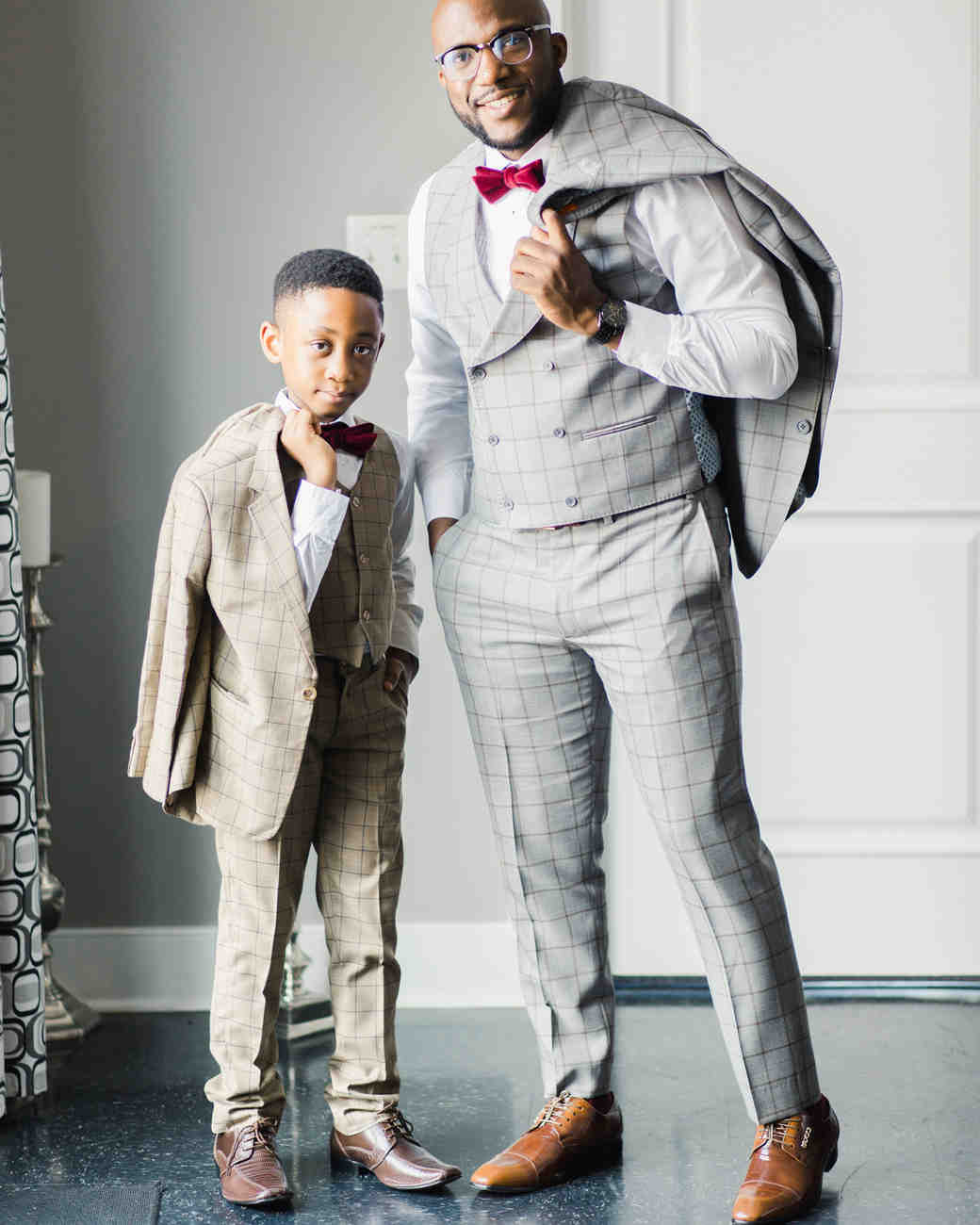 groom in grey suit with ring bearer in brown suit