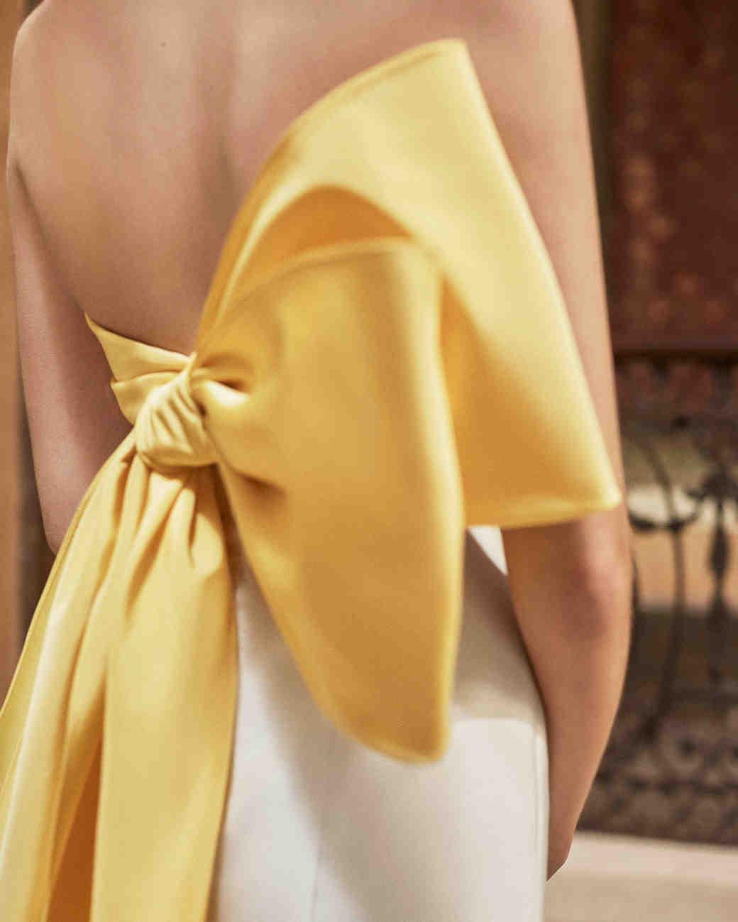 Carolina Herrera wedding dress spring 2019 sheath with gold bow in back
