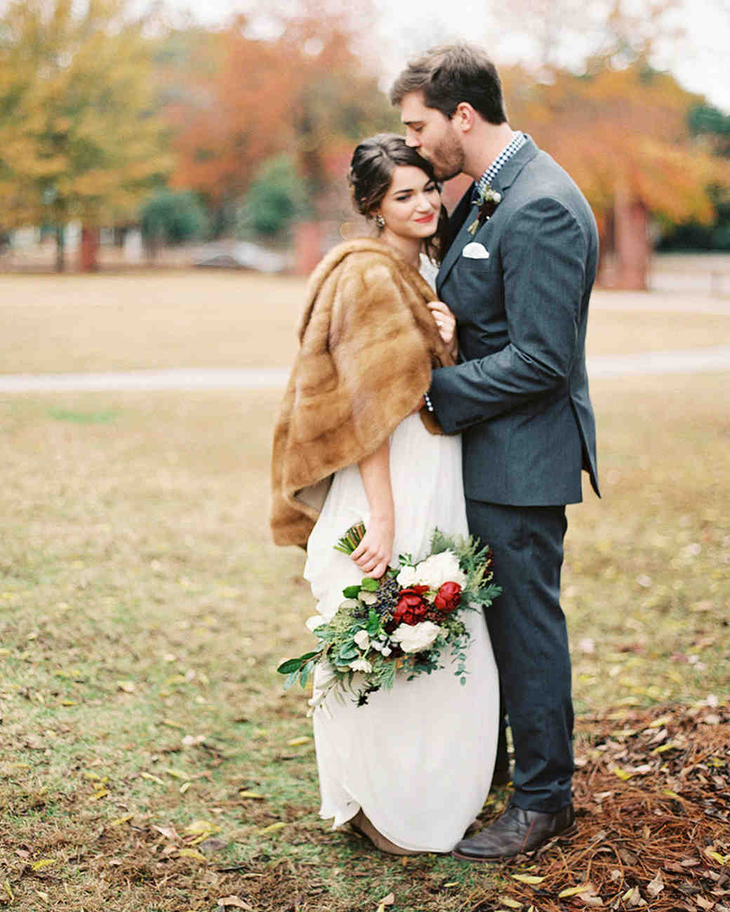 bride wearing fur groom