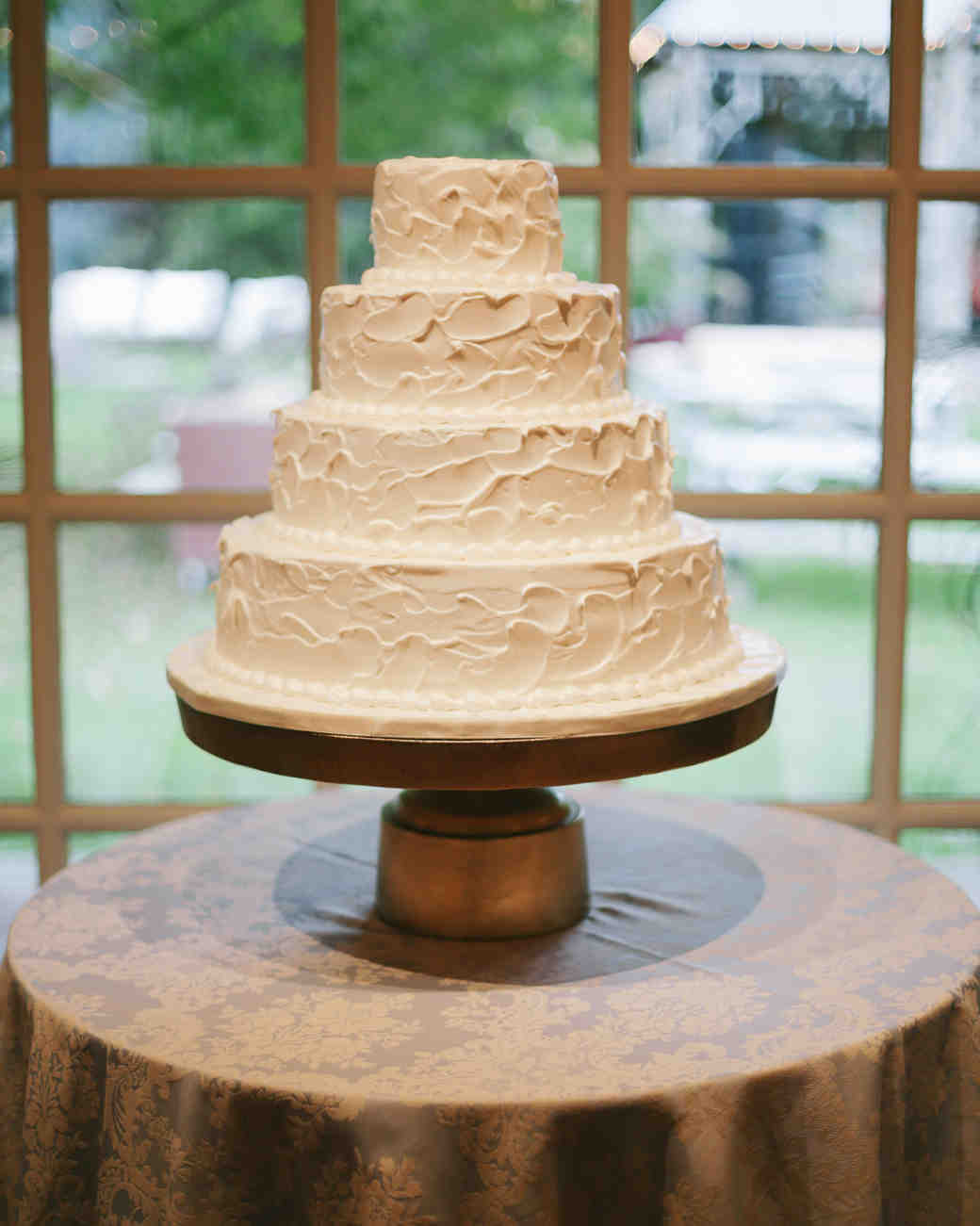 Four-Tiered White Wedding Cake with Textured Icing
