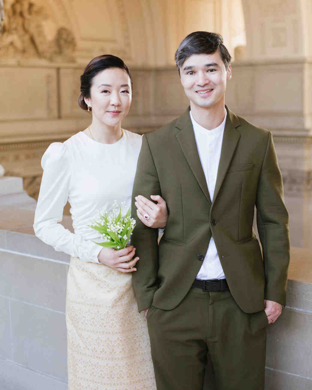 bride and groom wearing modern Thai wedding outfits