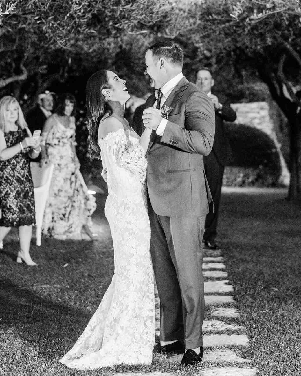 bride and groom first dance in Italian olive grove