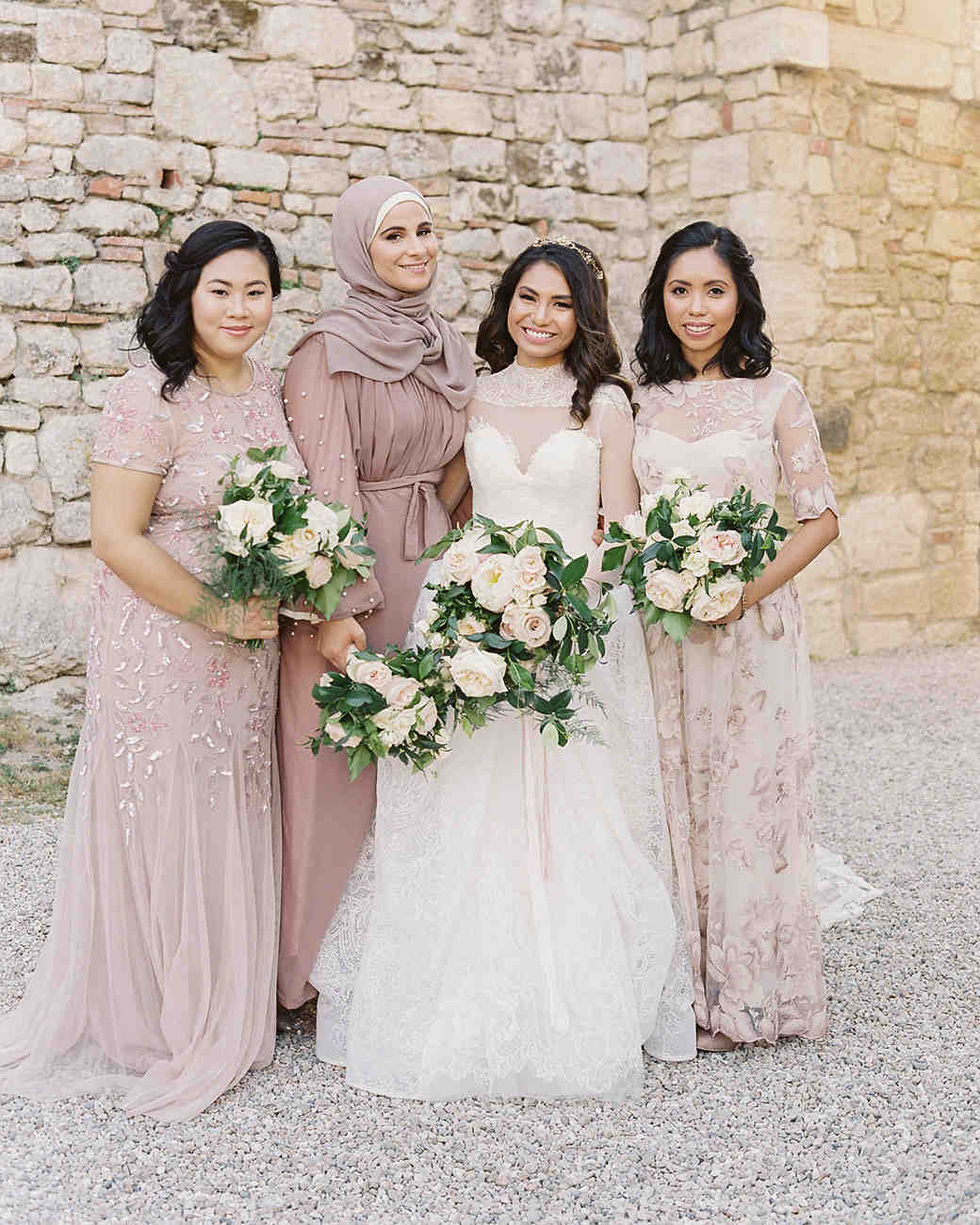 bride with bridesmaids wearing long blush toned dresses