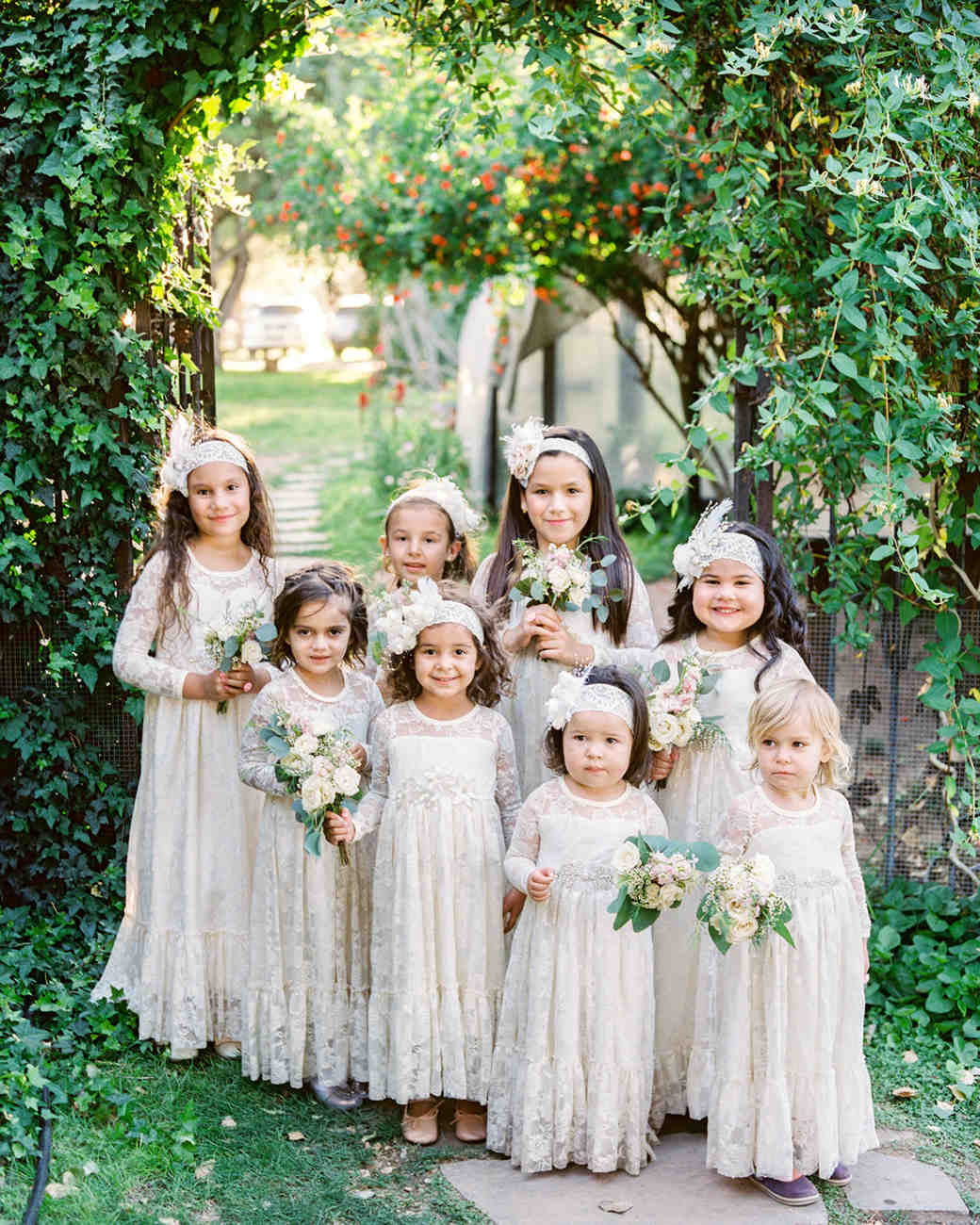 flower girls under arch