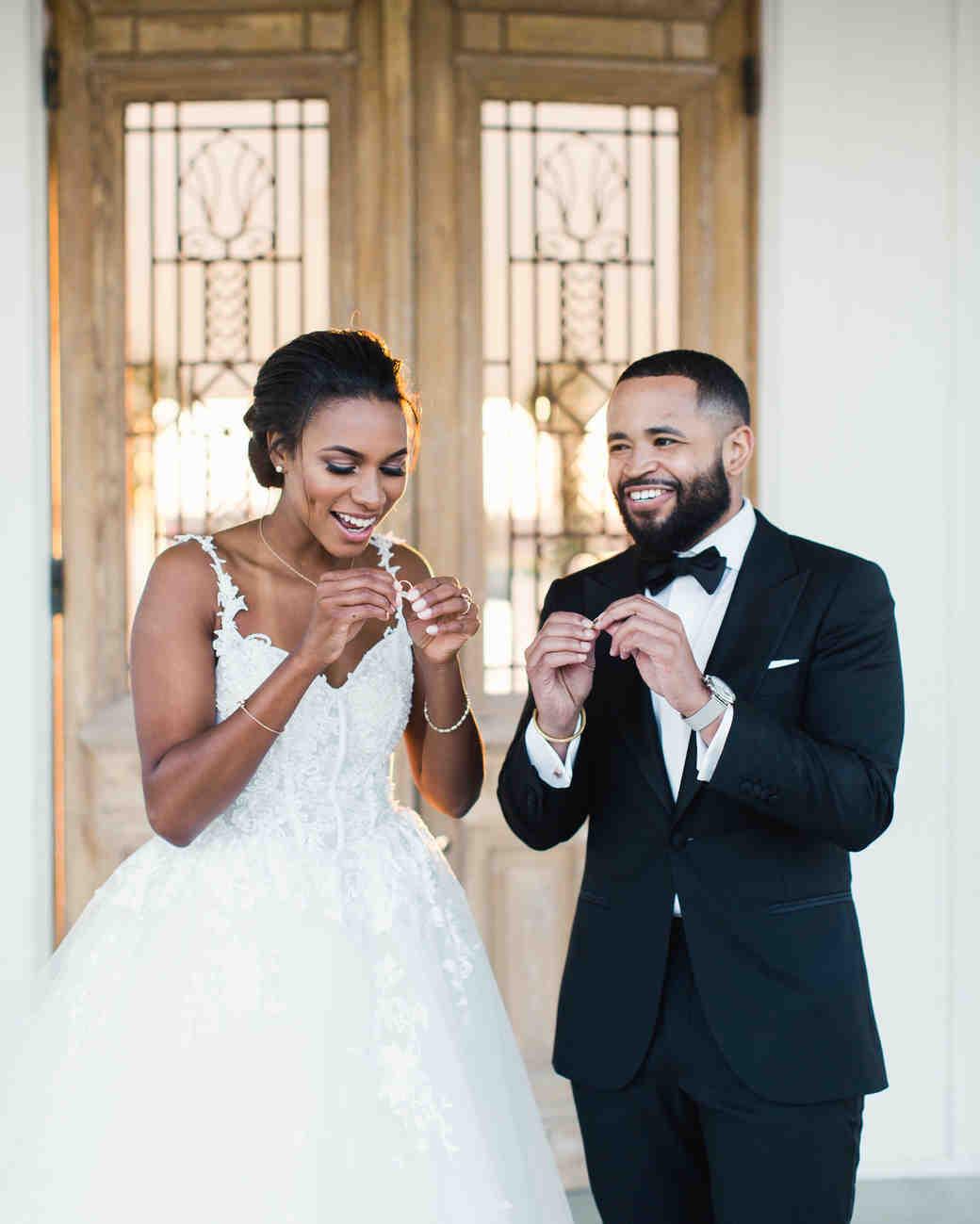 wedding couple looking at wedding rings
