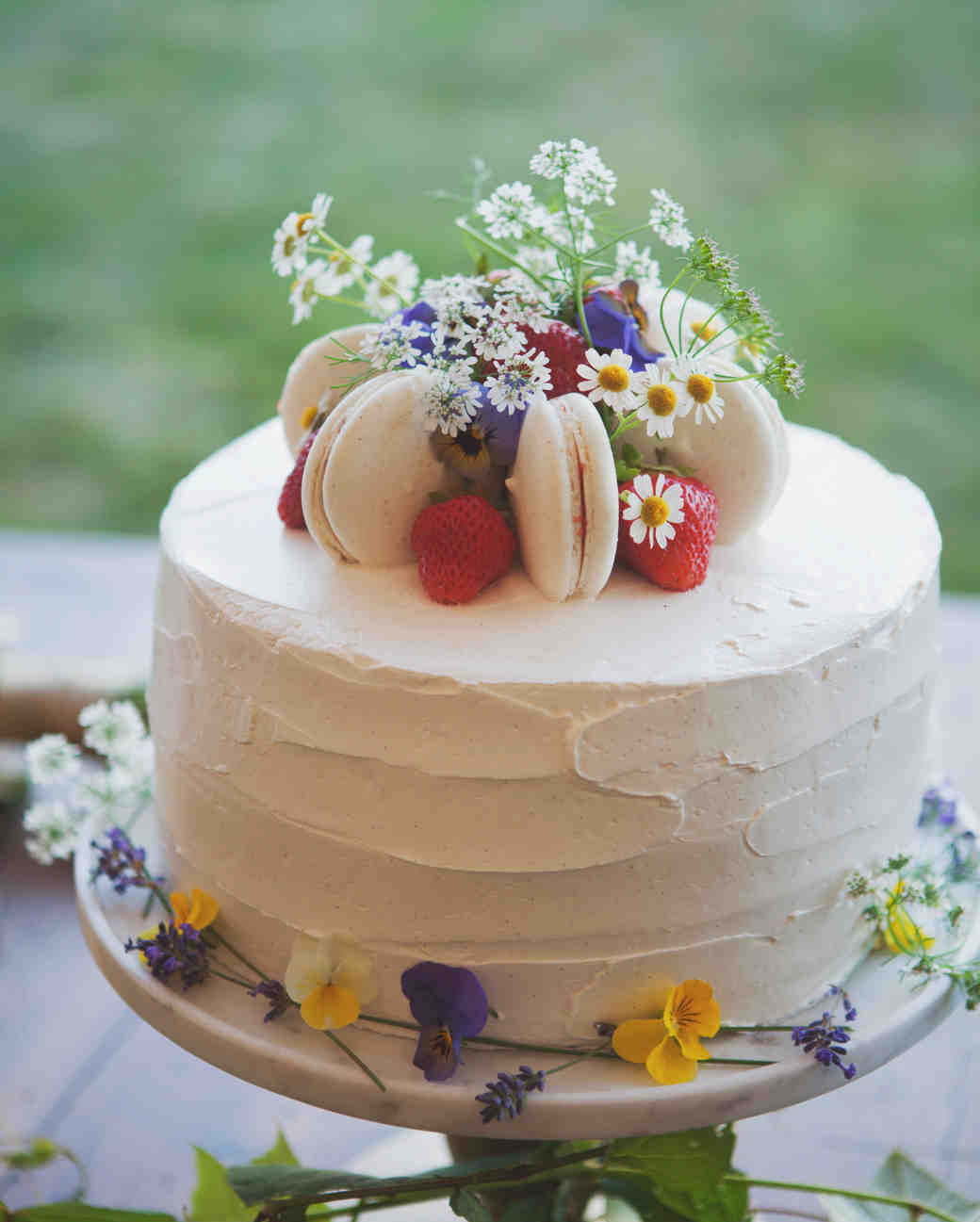 One-Tiered White Wedding Cake with Macarons, Strawberries, and Flowers