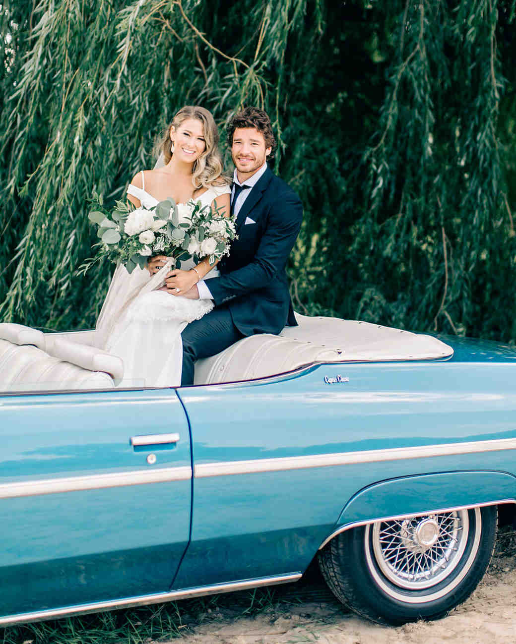 maggie zach wedding couple in vintage car
