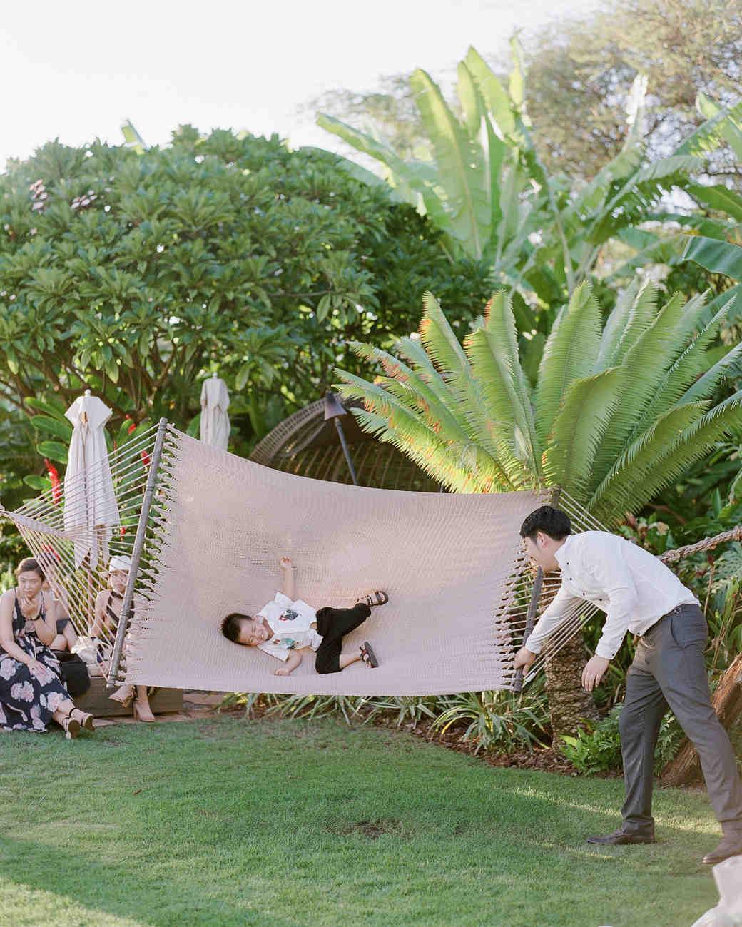 hawaiian wedding guests enjoy swing hammock