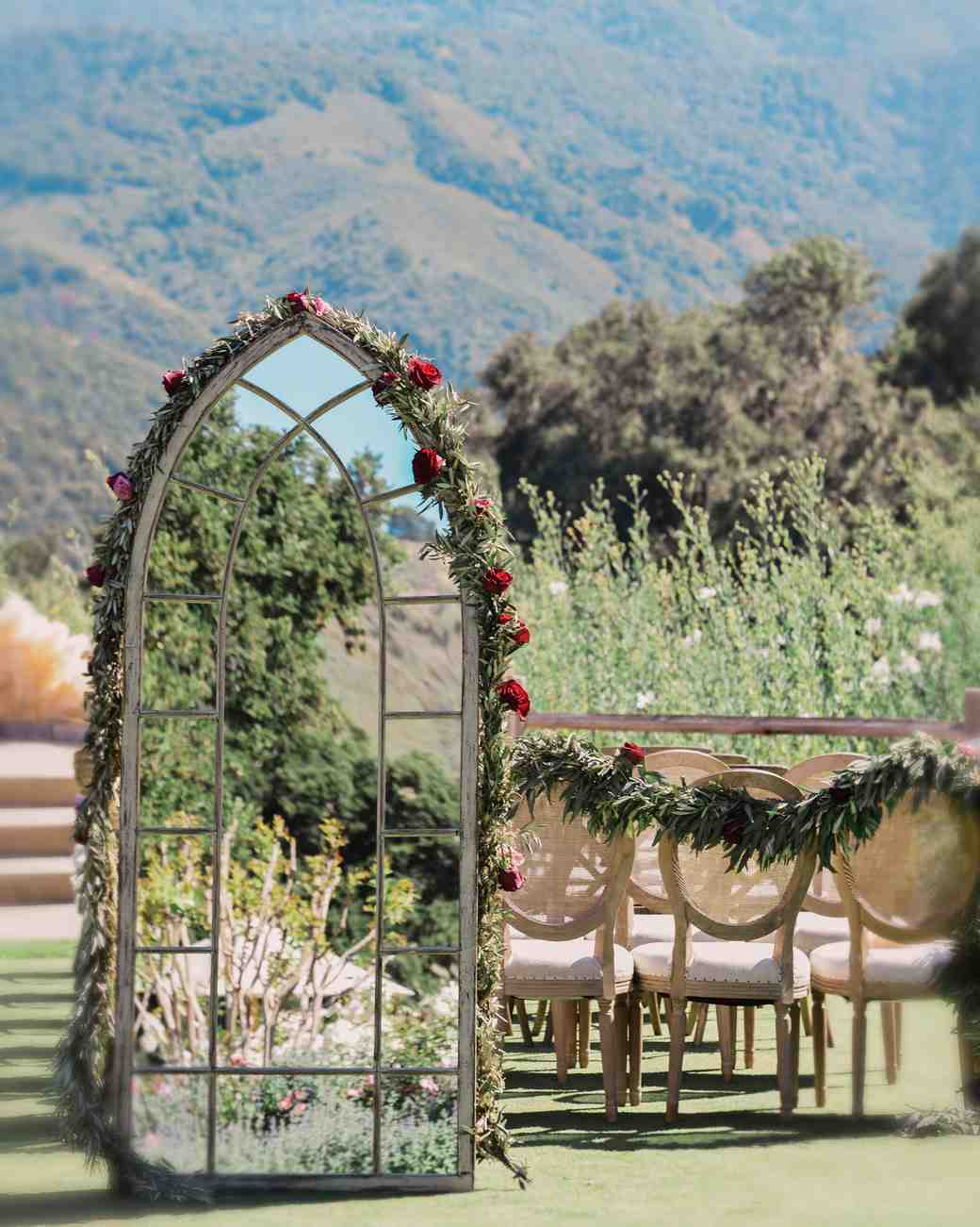 outdoor reception area with mirrored chapel window