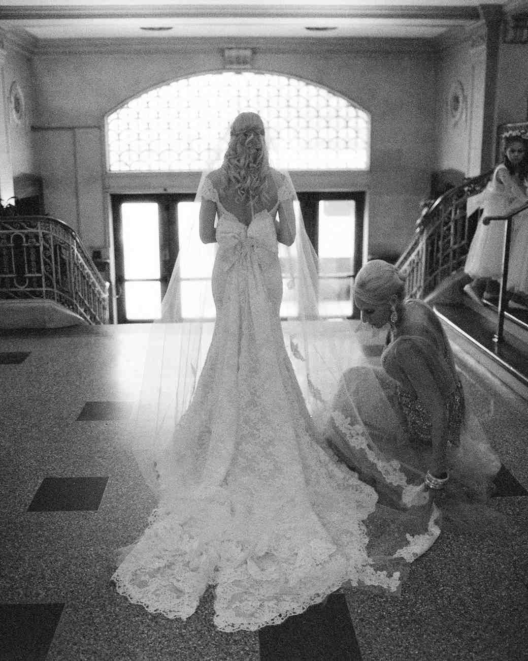 A Mother Helping Her Daughter with Her Wedding Dress Train