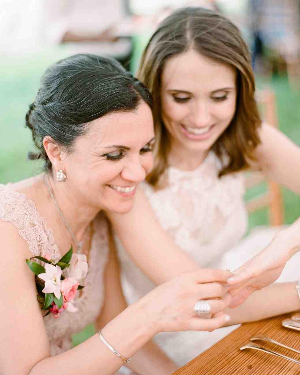 A Mother and Daughter Looking at Her Wedding Ring