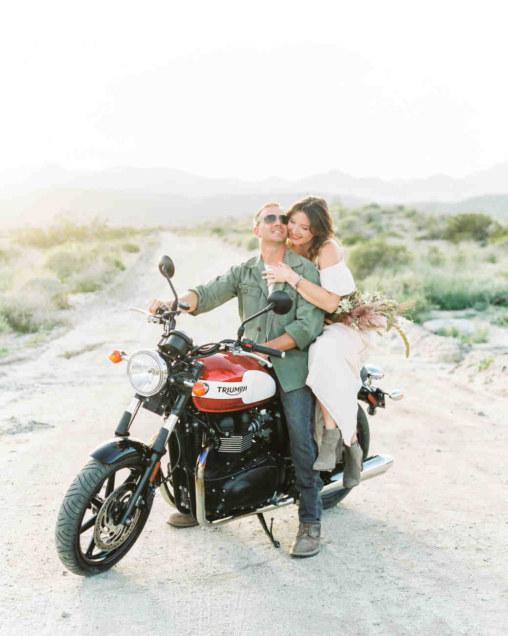 couple on motorcycle engagement photo