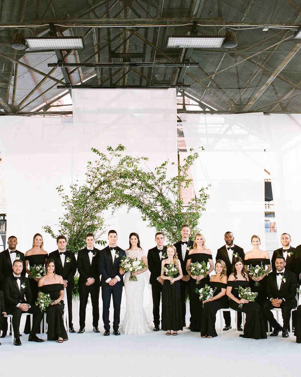 wedding party group shot white back drop