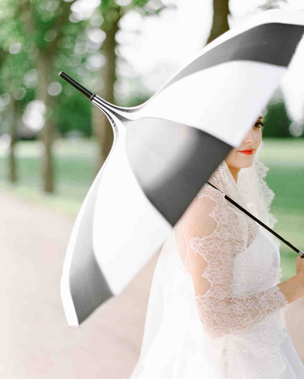 bride holding striped umbrella
