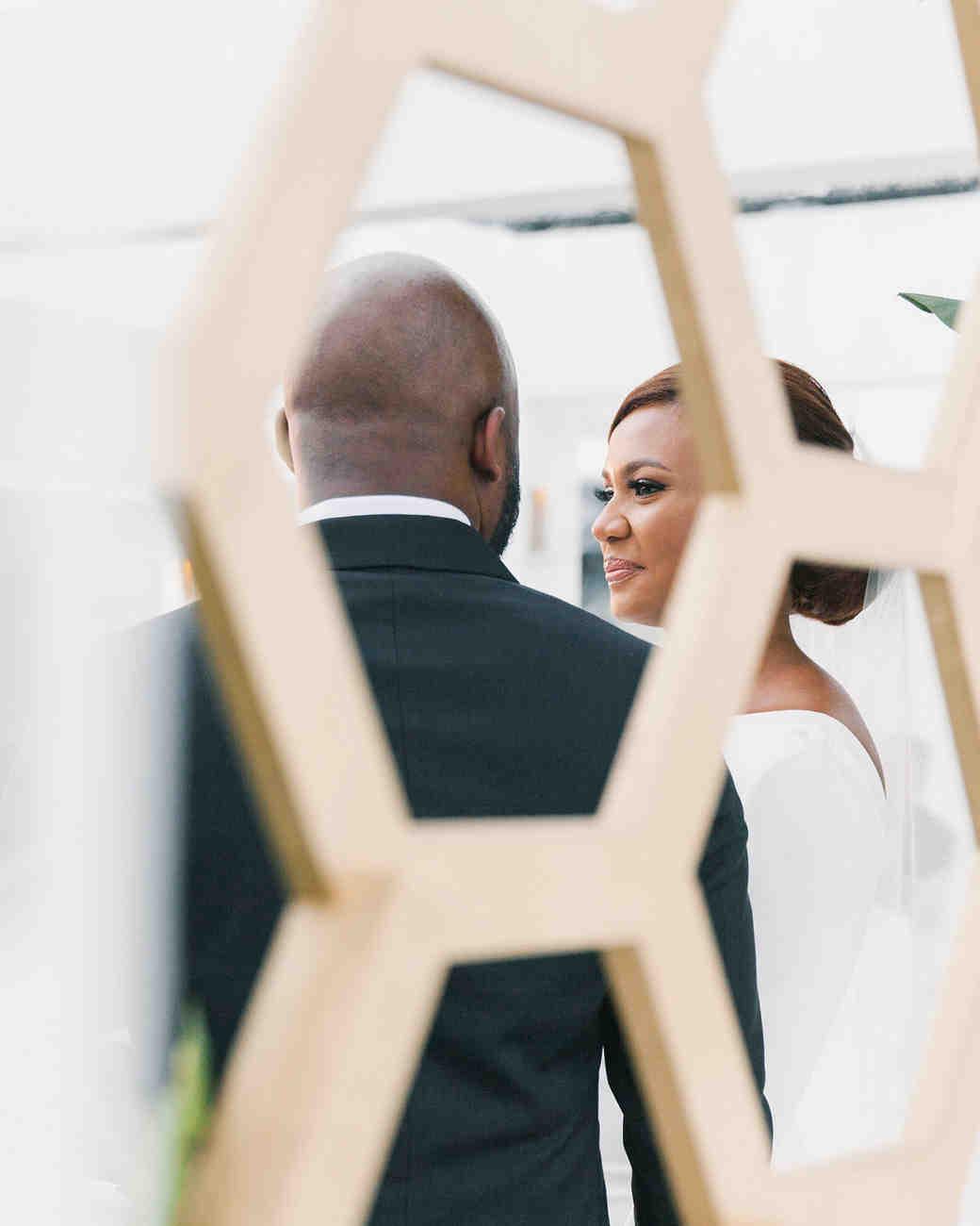vanessa abidemi wedding couple through golden fence