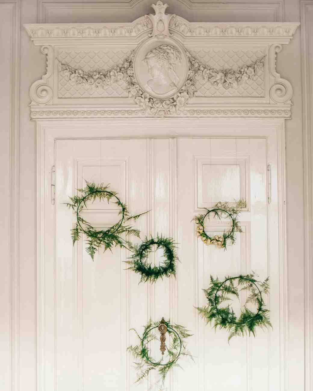winter rehearsal dinner wreath decor doorway