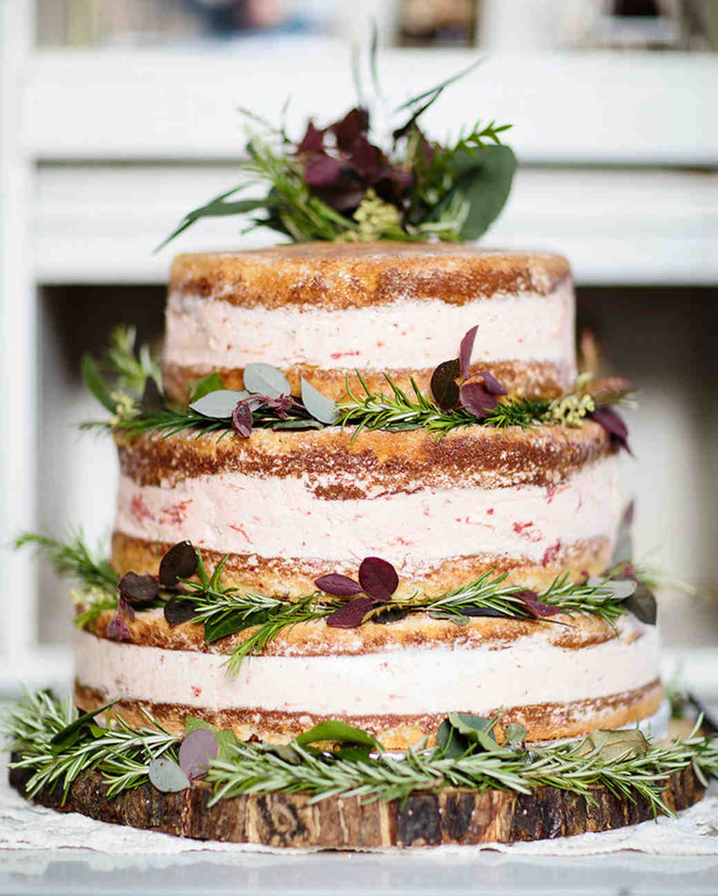 naked cake with fresh flowers plants garnish