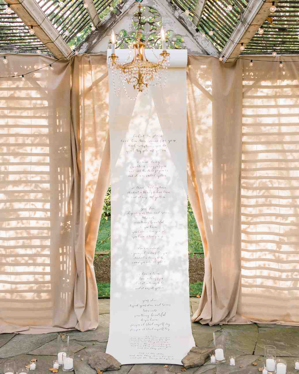 wedding ceremony backdrop hanging scroll candles rocks