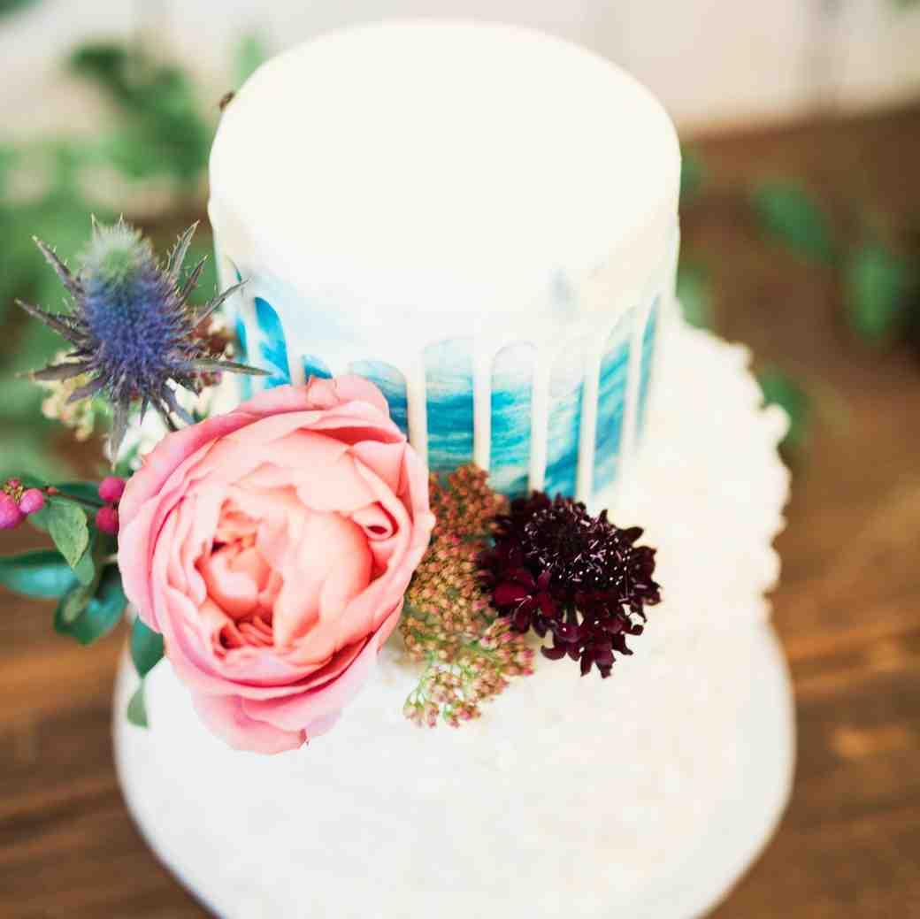 white and blue drip cake