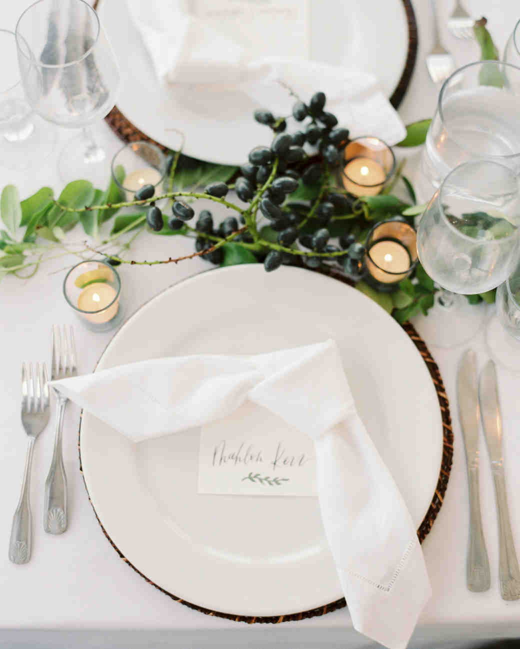 close-up white wedding place setting