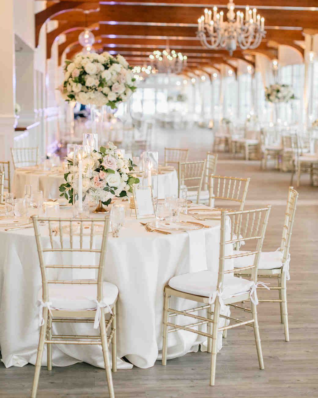 reception hall with white round tables