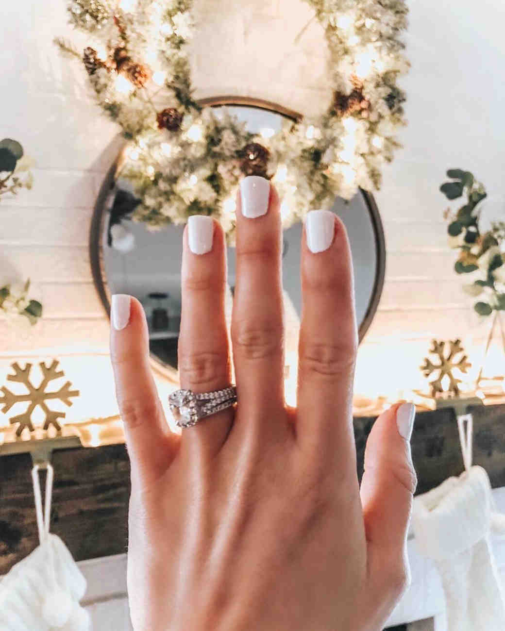 engagement ring selfie mantel with christmas decor