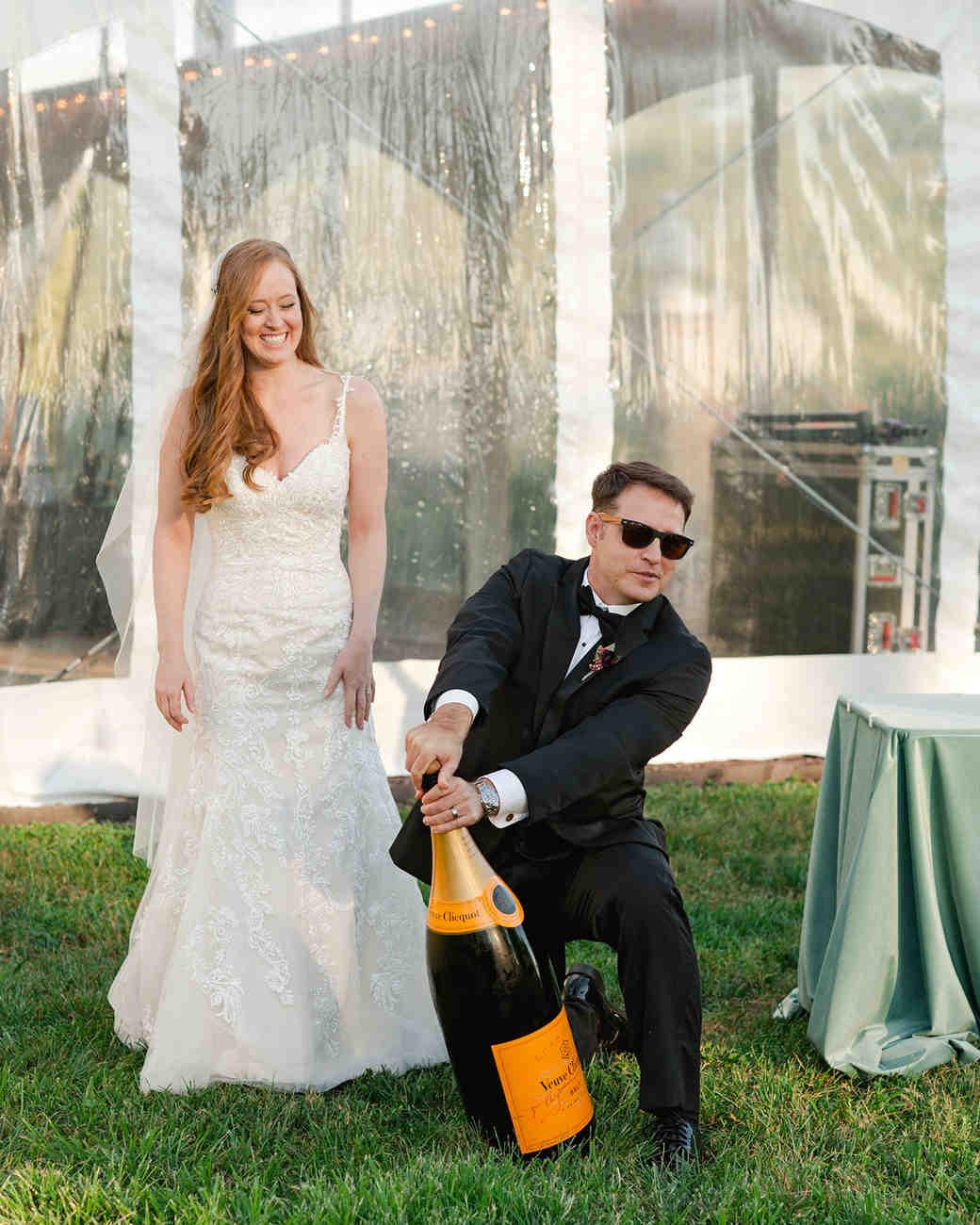 jen geoff wedding groom opening champagne