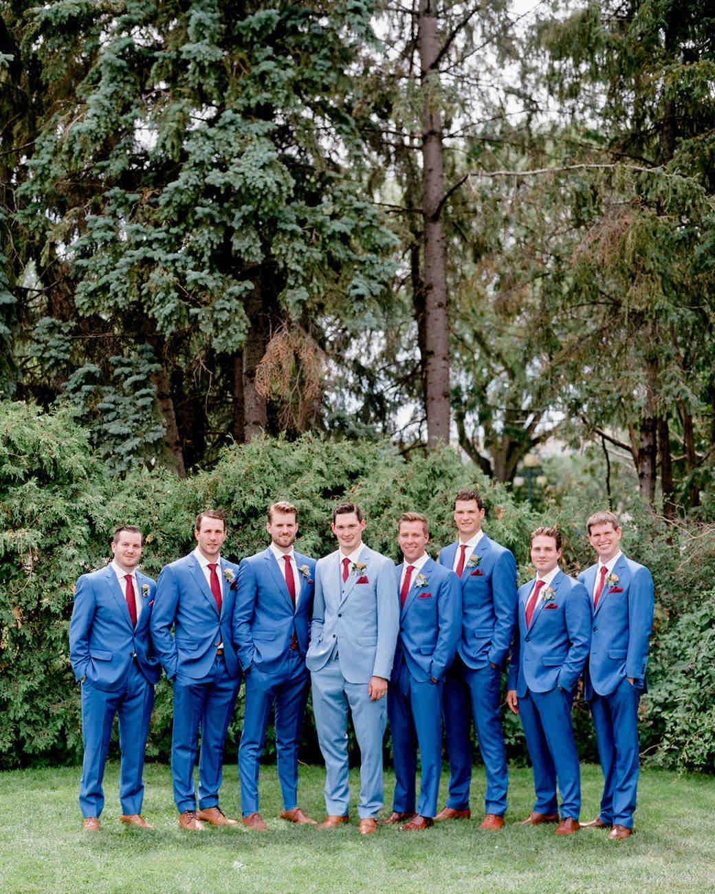 groom with groomsmen wearing blue suits