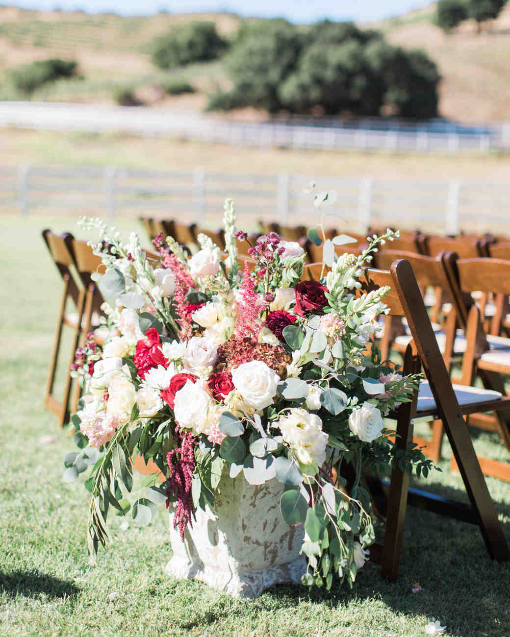 last row ceremony chair decorations white and red floral arrangement in large vessel