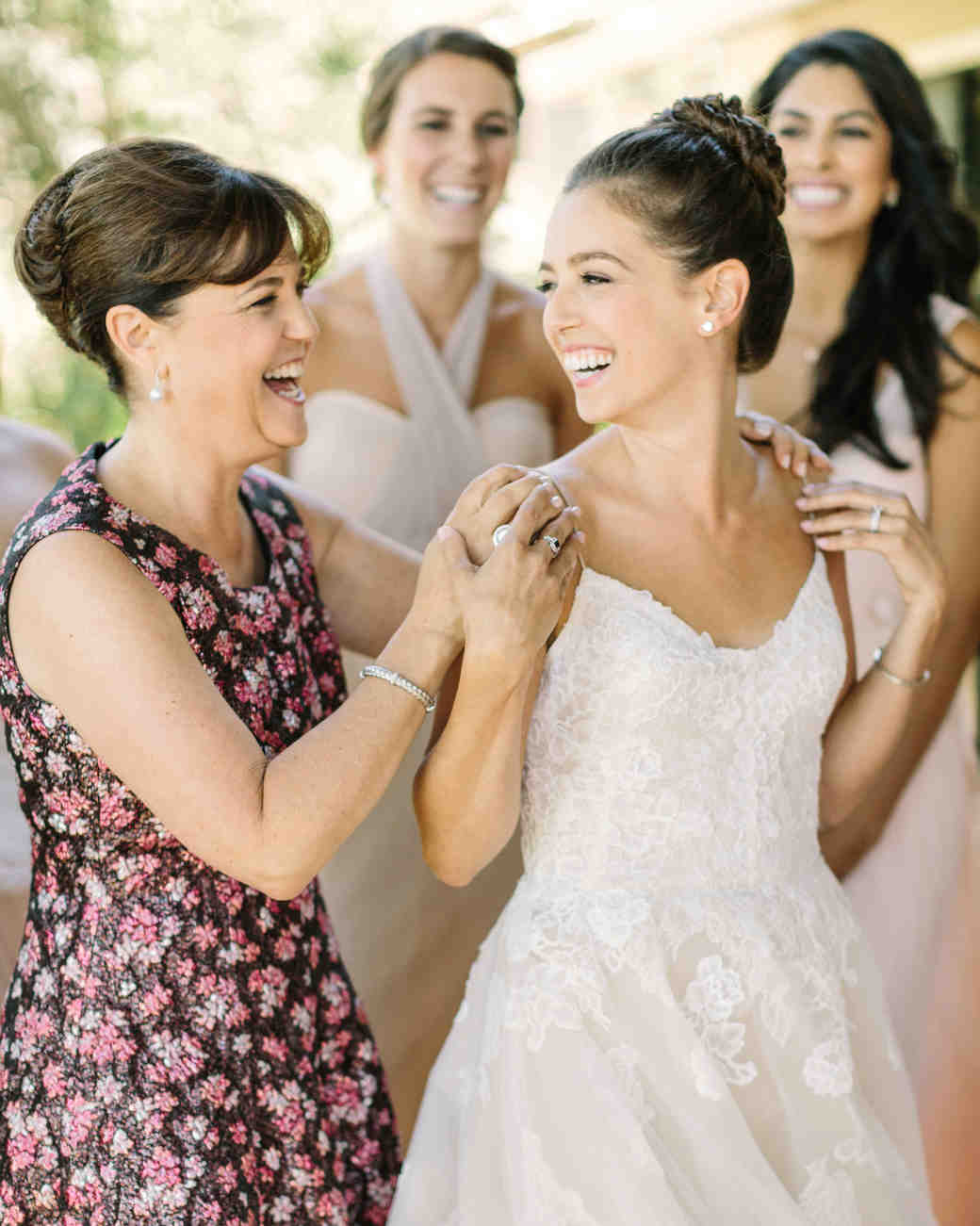 A Mother Holding Her Daughter's Shoulders on Her Wedding Day