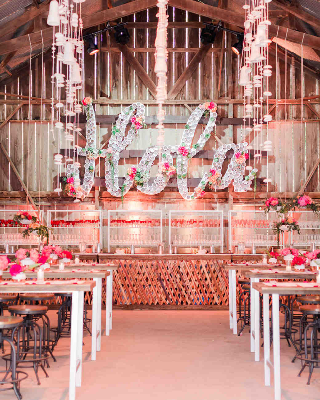 barn cocktail hour with floral decor