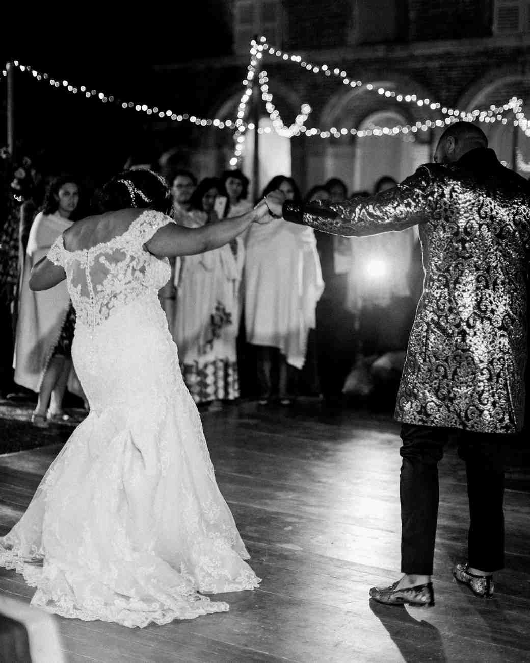 bride and groom with guests dancing during reception