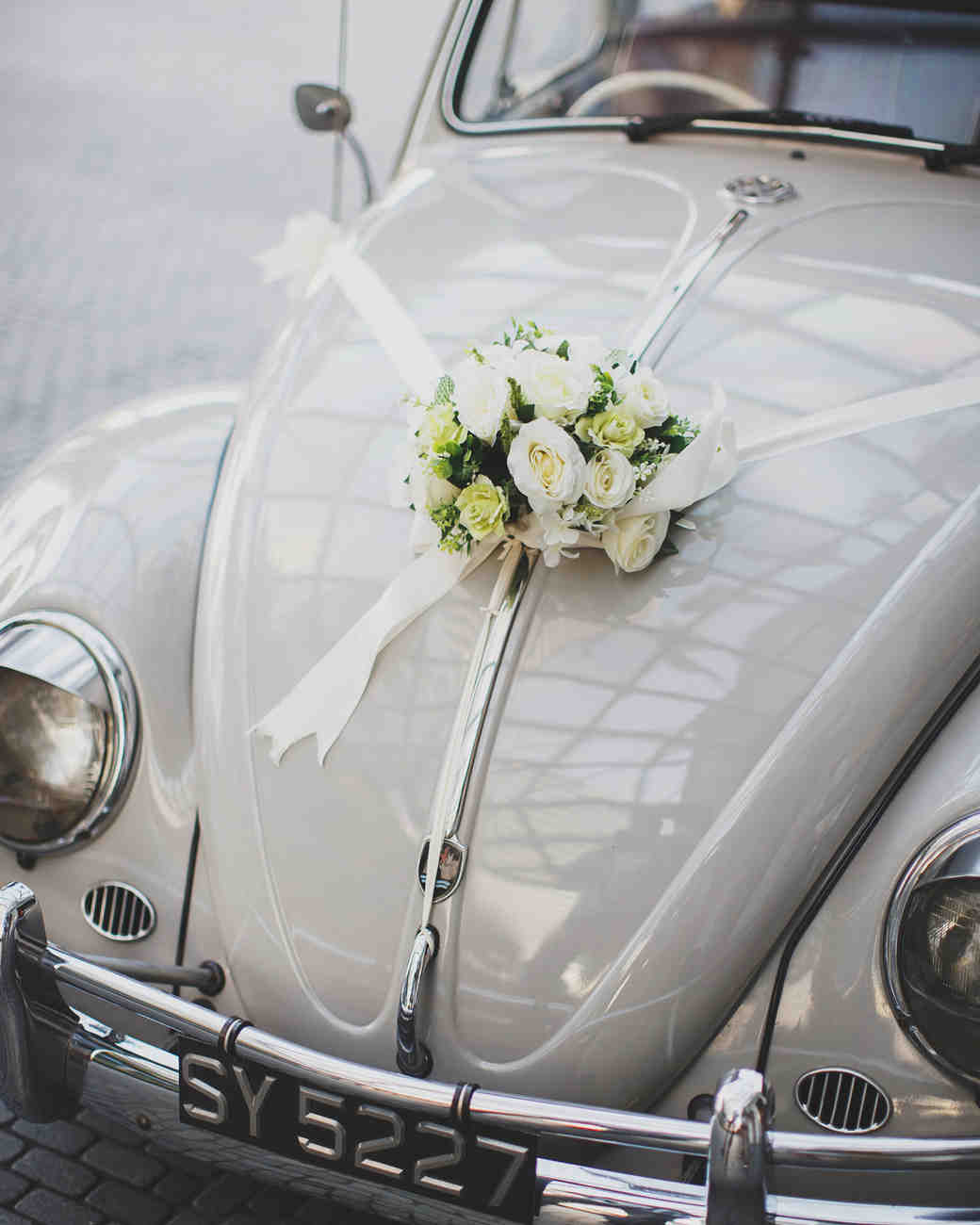 ribbon wedding ideas white ribbon and bouquet adhered to hood of vintage beetle
