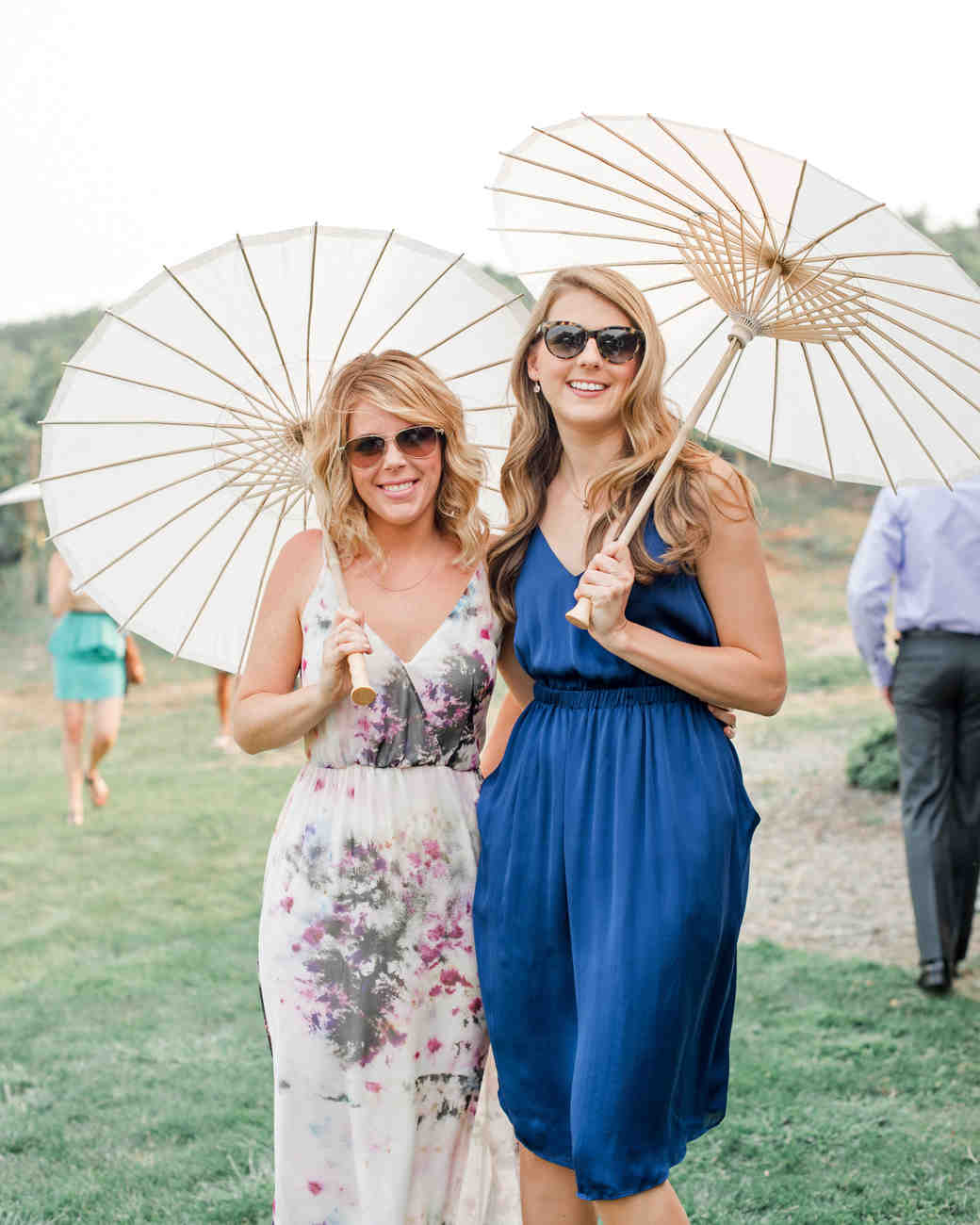 summer wedding guests sleeveless dresses parasols