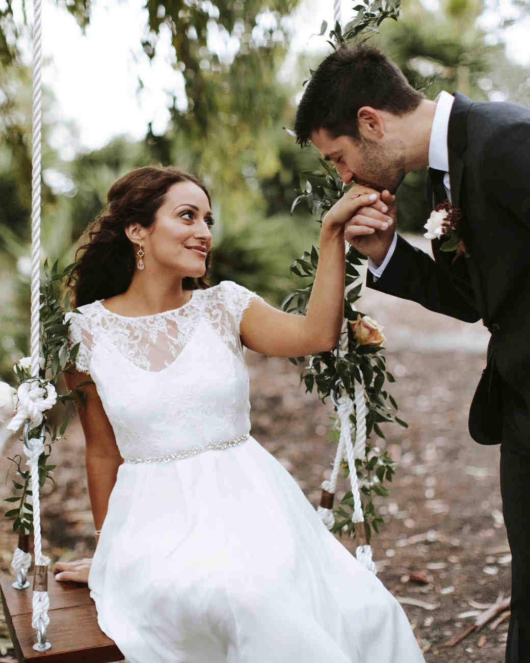 timeless wedding photos couple swing kiss hand