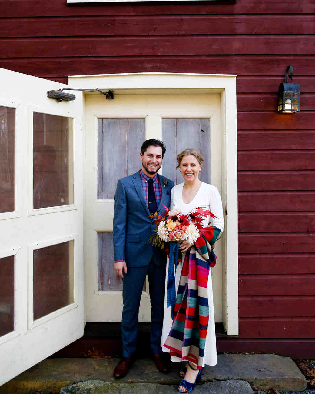 tory jonathan wedding couple in front of door