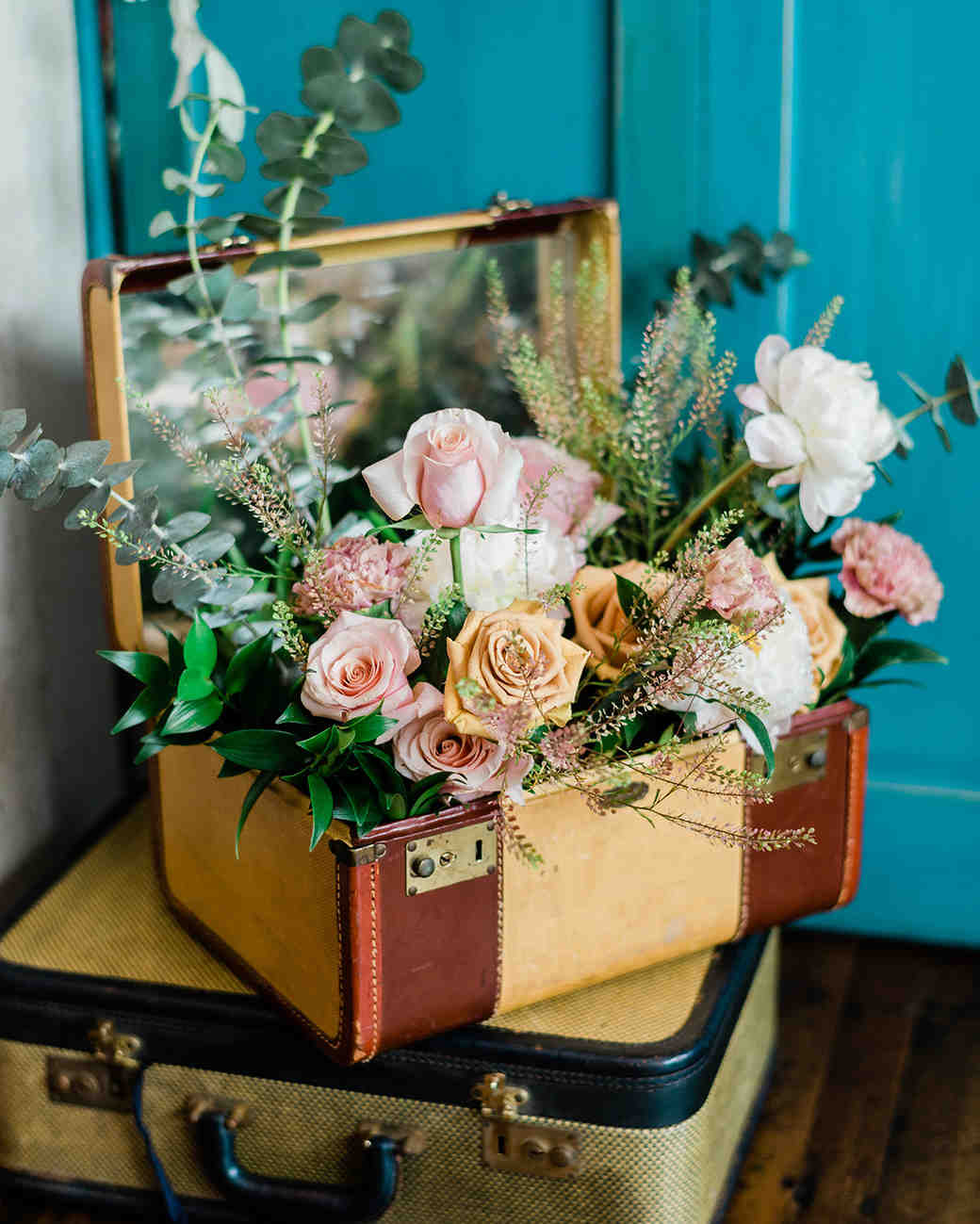 vintage suitcases filled with flowers