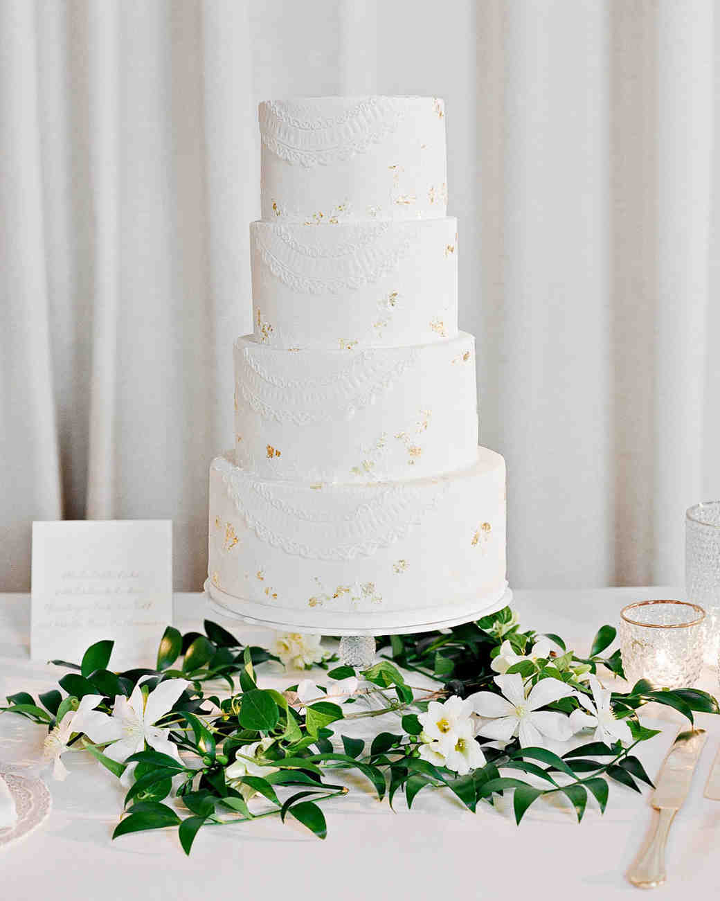 Gold Leaf Wedding Cake with Greenery and White Flowers