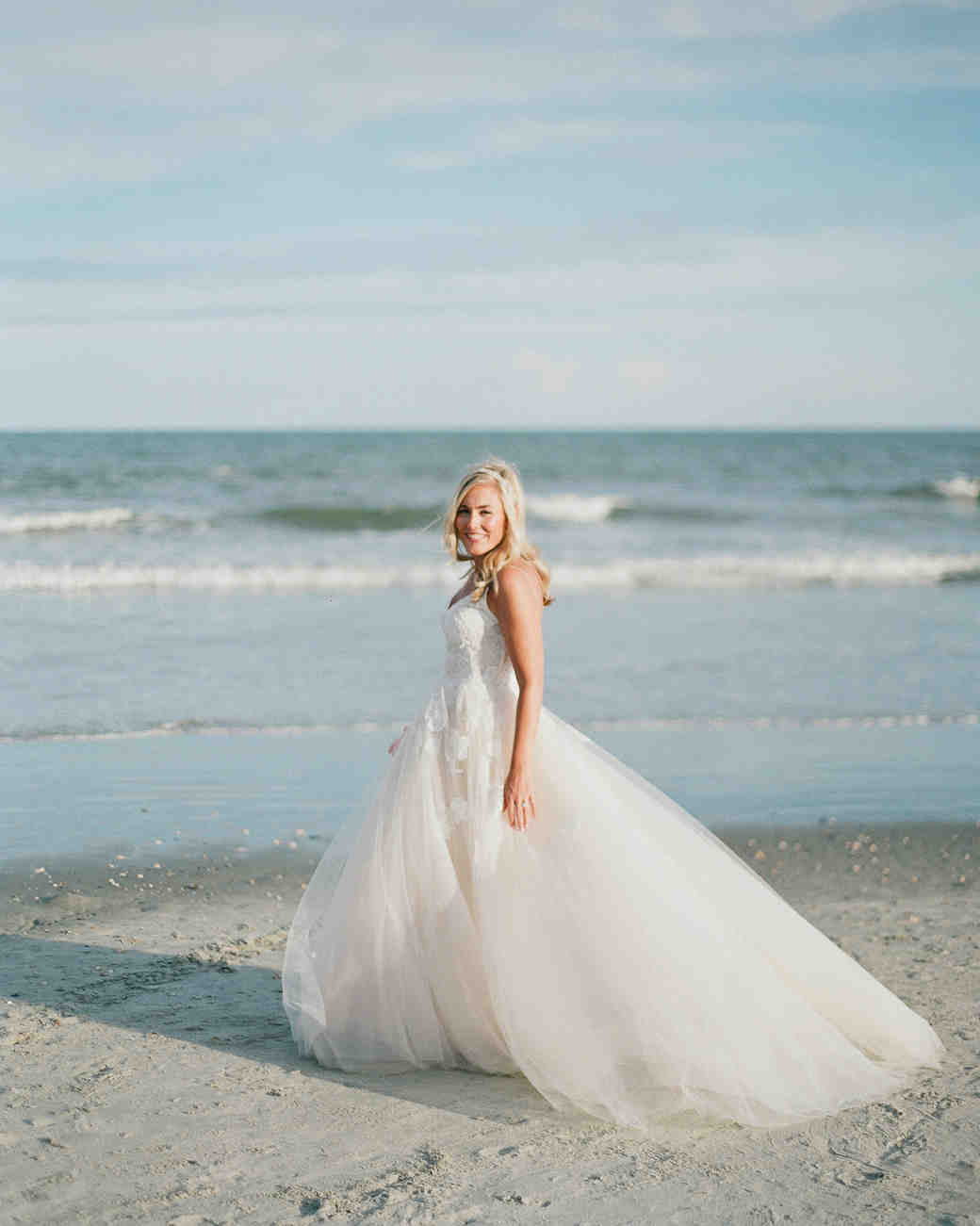 beach wedding dresses bride in ball gown on the beach