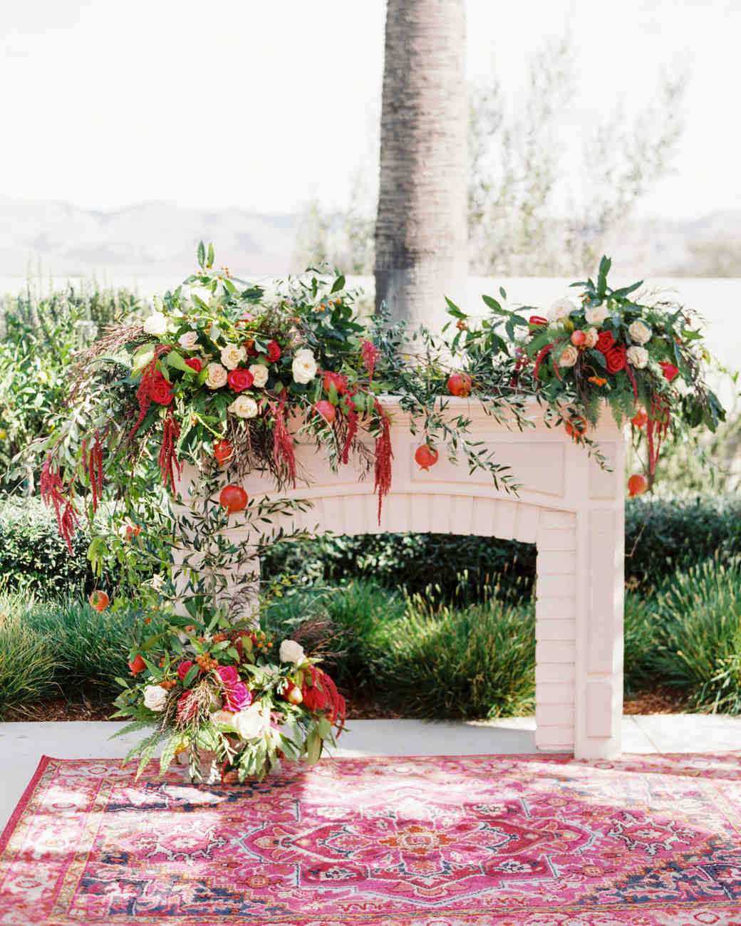 freestanding fireplace backdrop floral arrangement