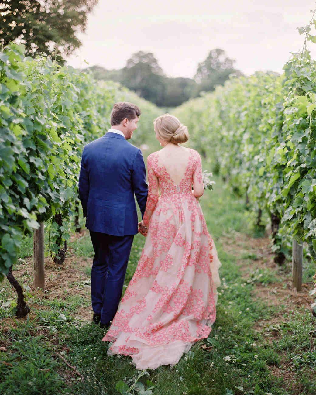 wedding couple walking vineyard