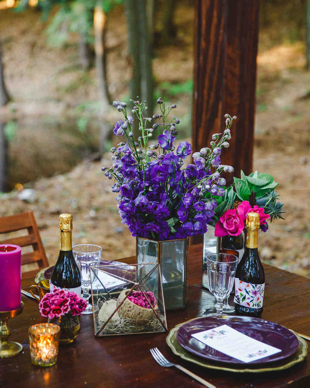 centerpiece with purple and magenta flowers