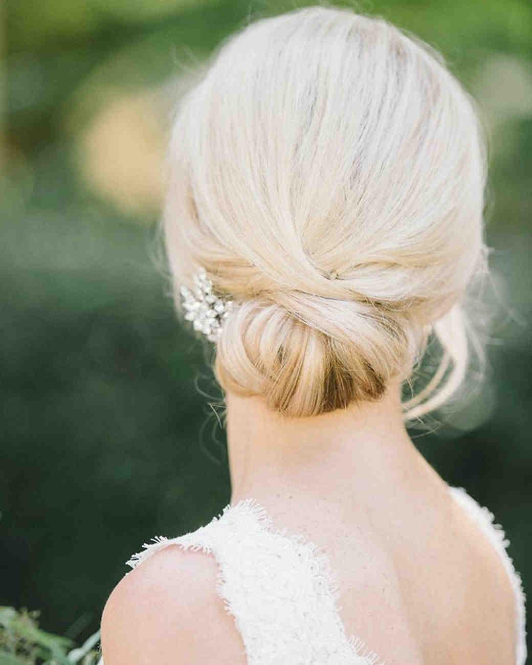 bride hairstyle low bun classic volume
