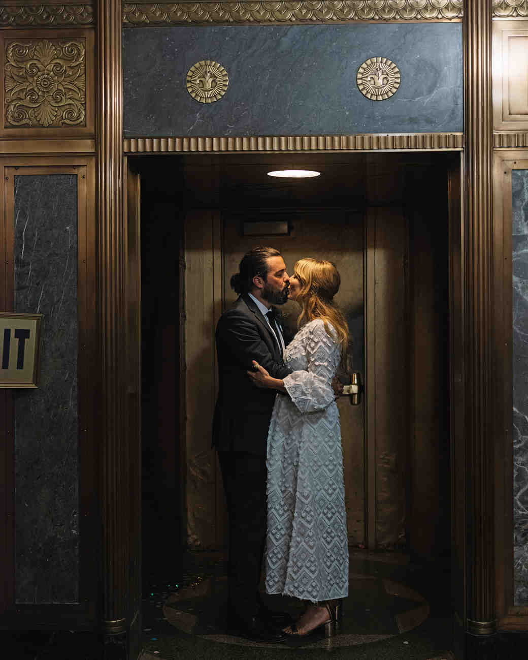 morgan jon paul wedding couple kissing in doorway