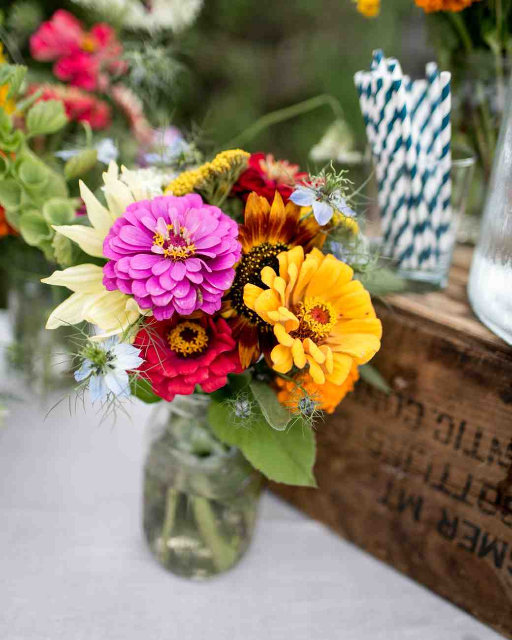 Bright dahlia and sunflower wedding centerpieces