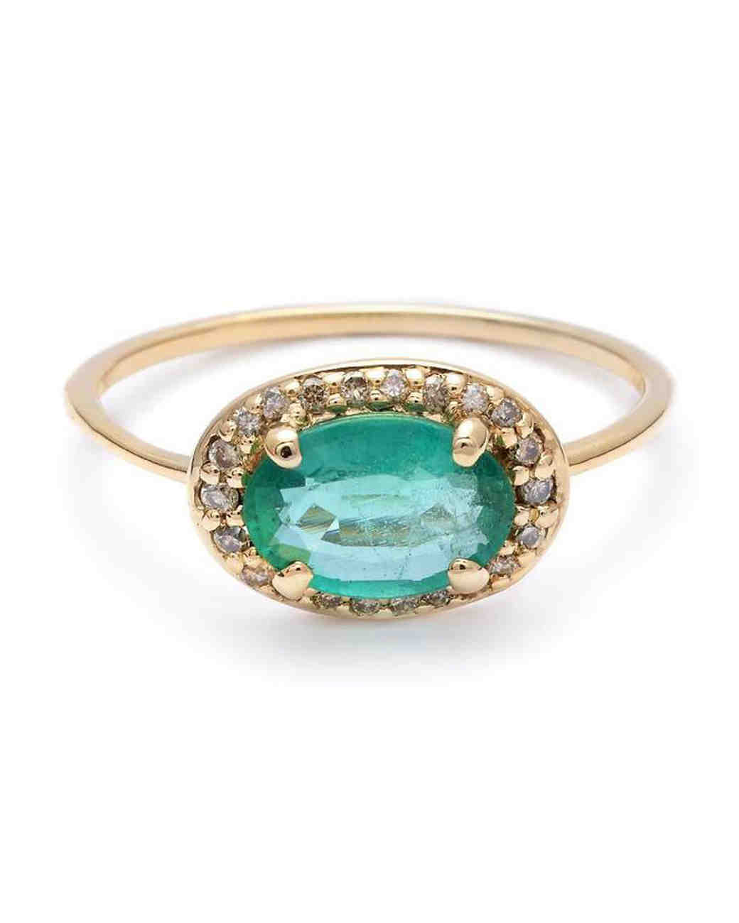 green stone unique engagement ring