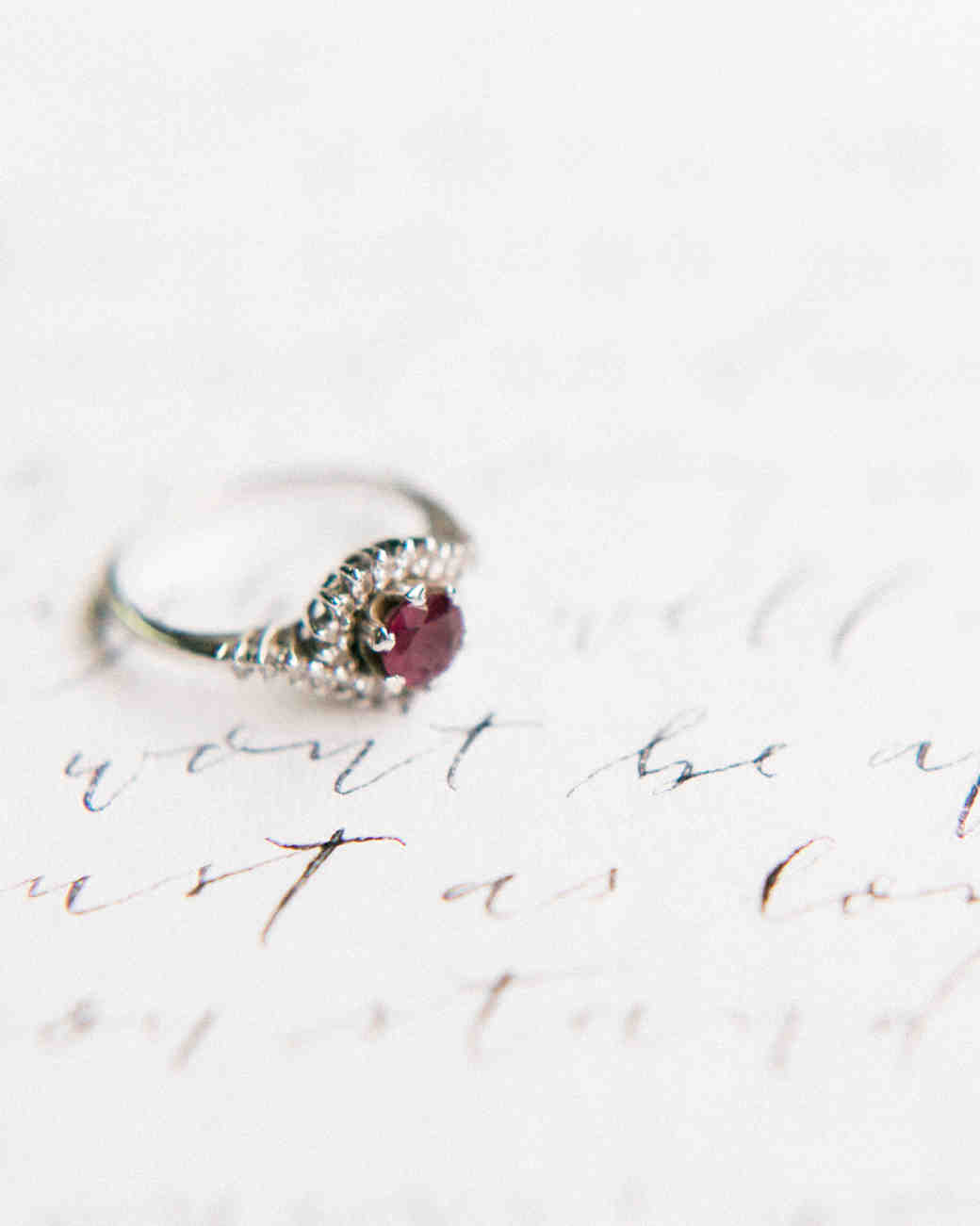 silver band engagement ring with purple stone