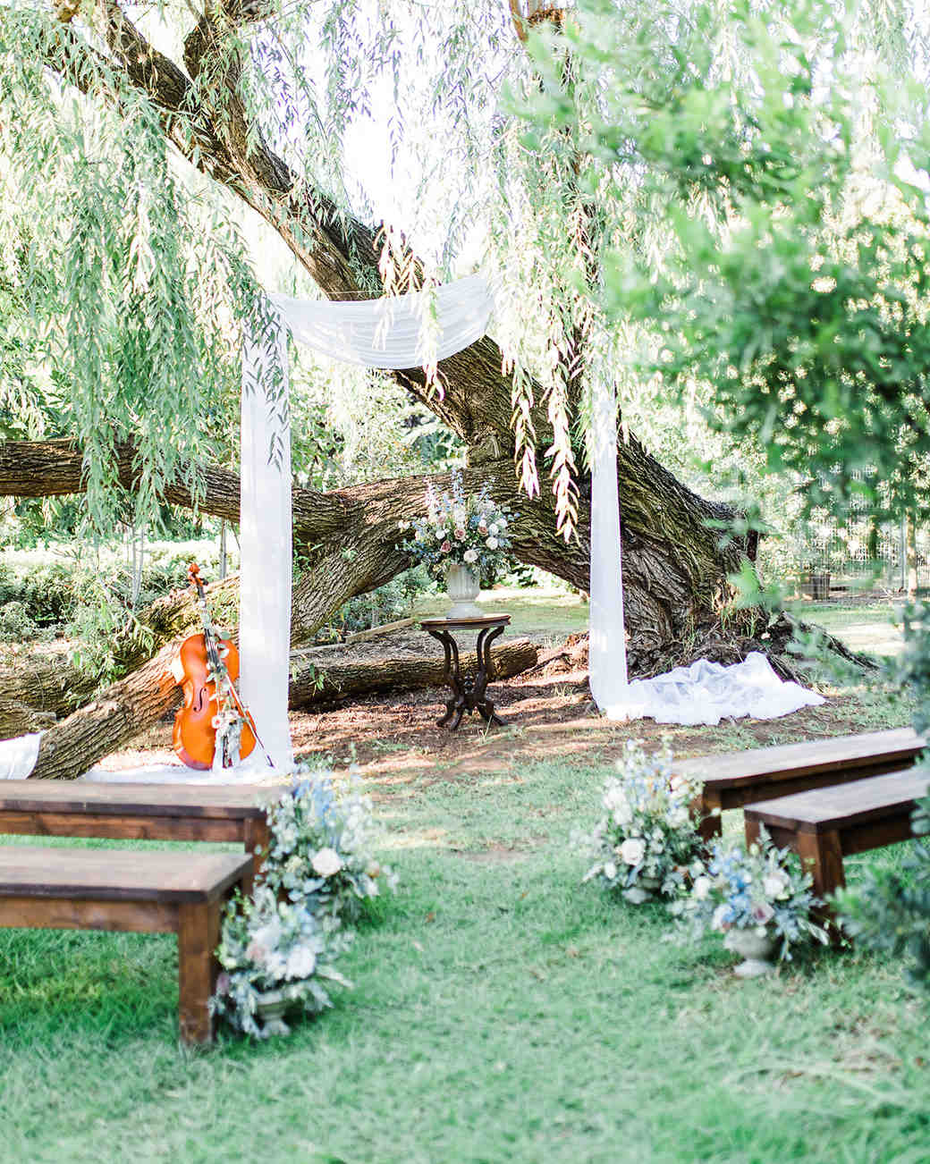 outdoor wedding altar with cello