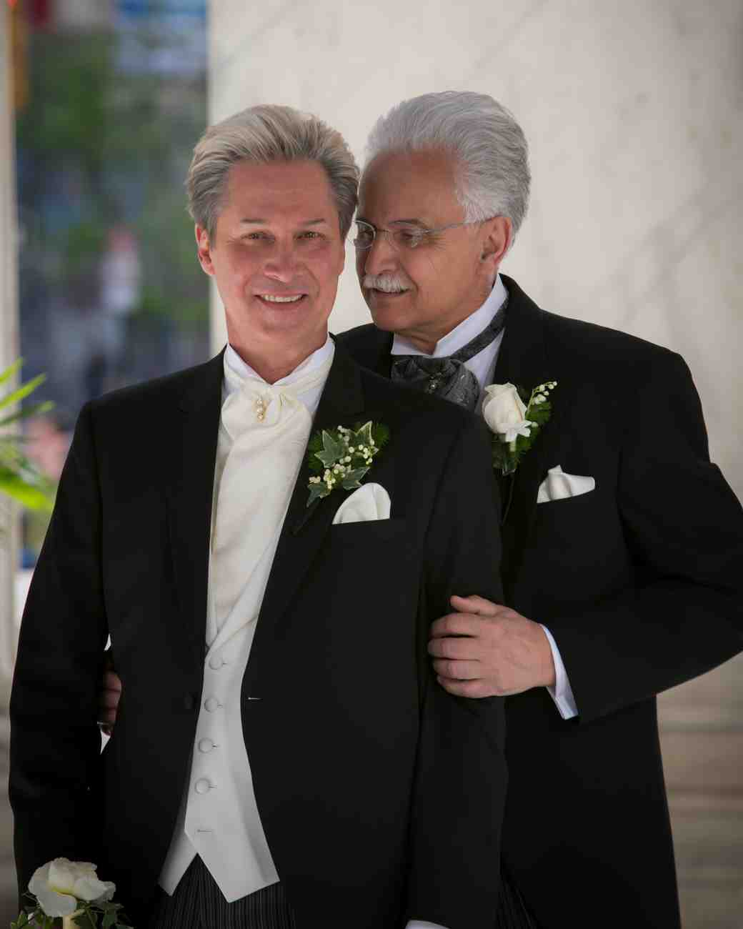 grooms standing together